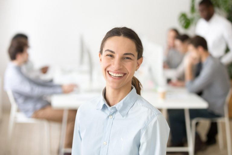 Woman Wearing White Shirt & Smiling