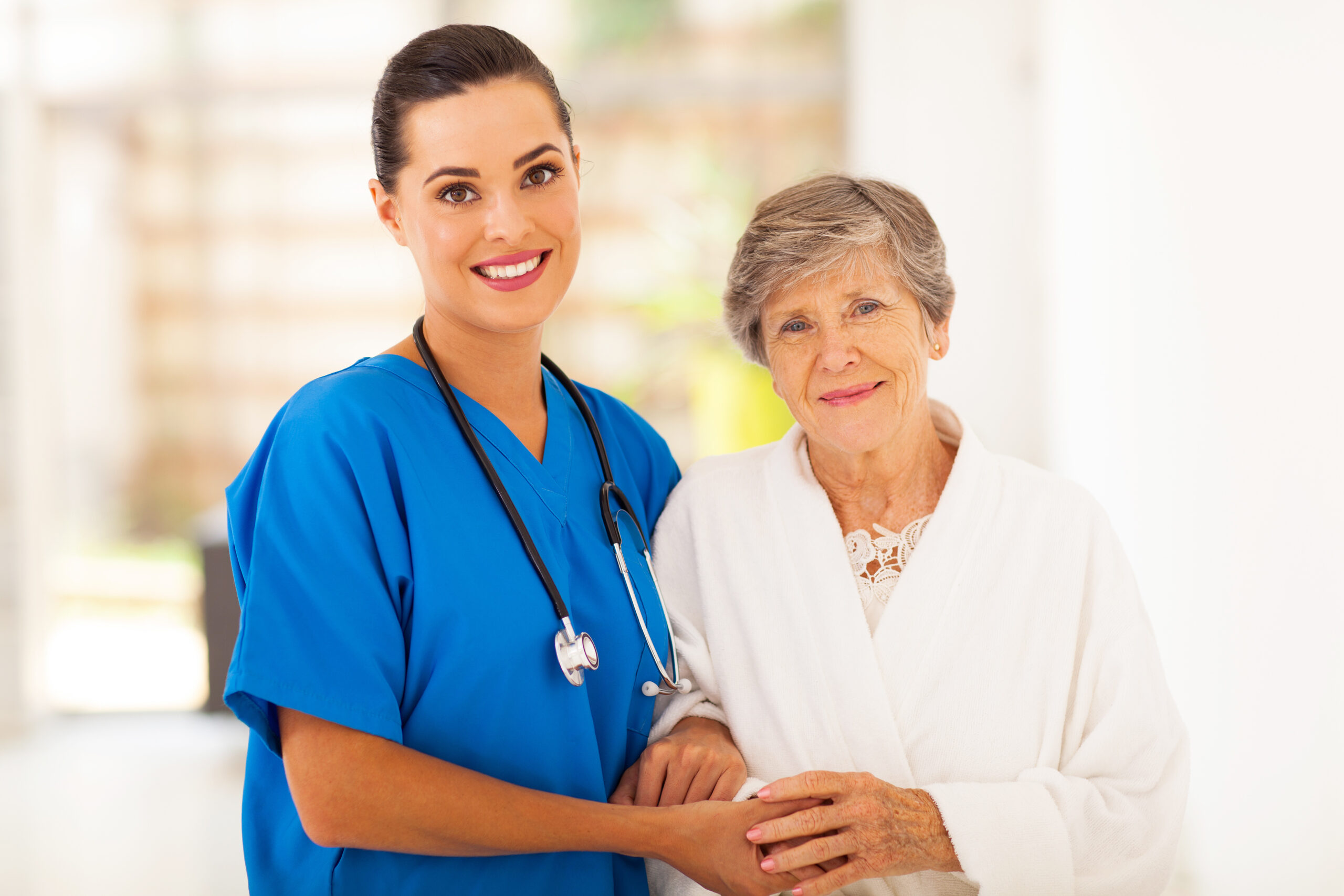 Nurse Holding Hands With Old Lady
