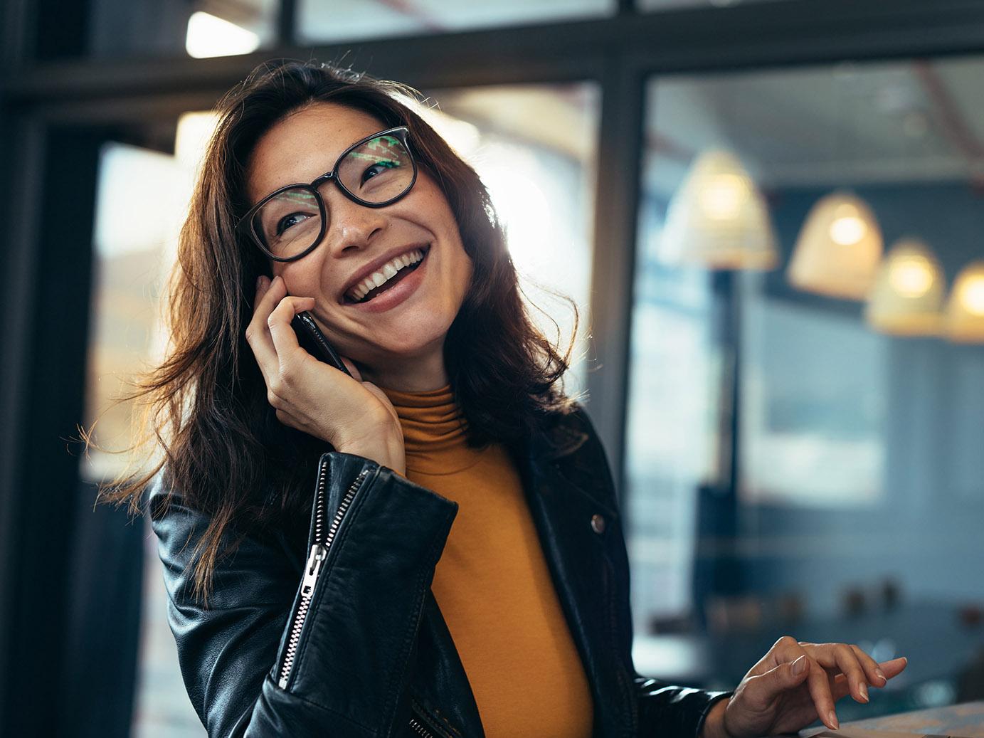 Woman smiling & using phone